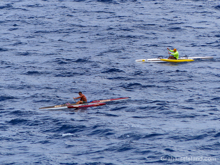 Two outrigger canoes off the coast of Hawaii