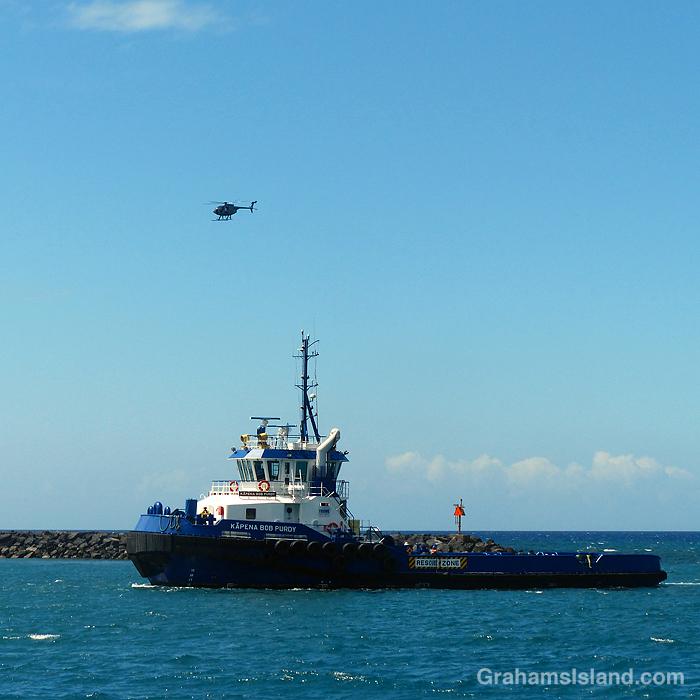 A tug enters Kawaihae Harbor in Hawaii