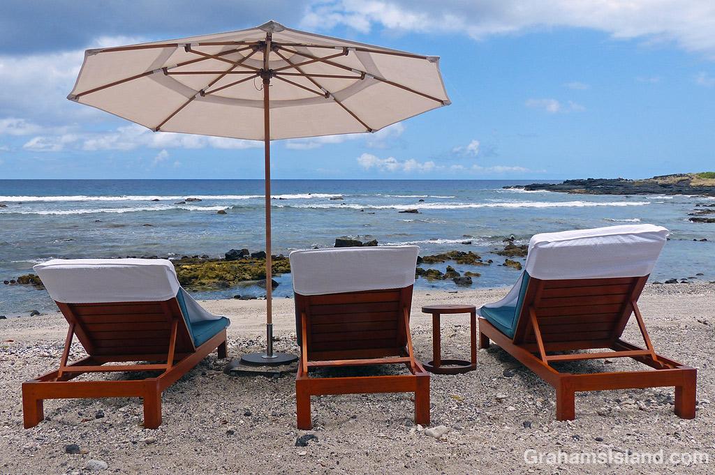 Beach chairs in front of the Kohanaiki Beach Club, Hawaii