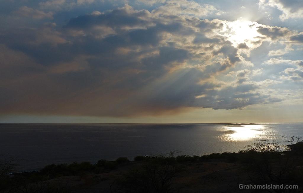 Smoke hangs in the sky off the Kohala Coast Hawaii