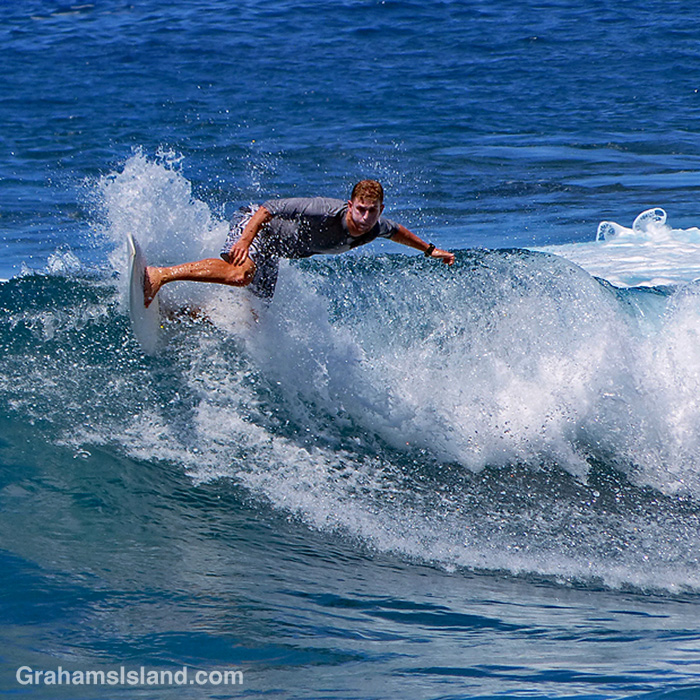 A surfer at Pine Trees, Hawaii
