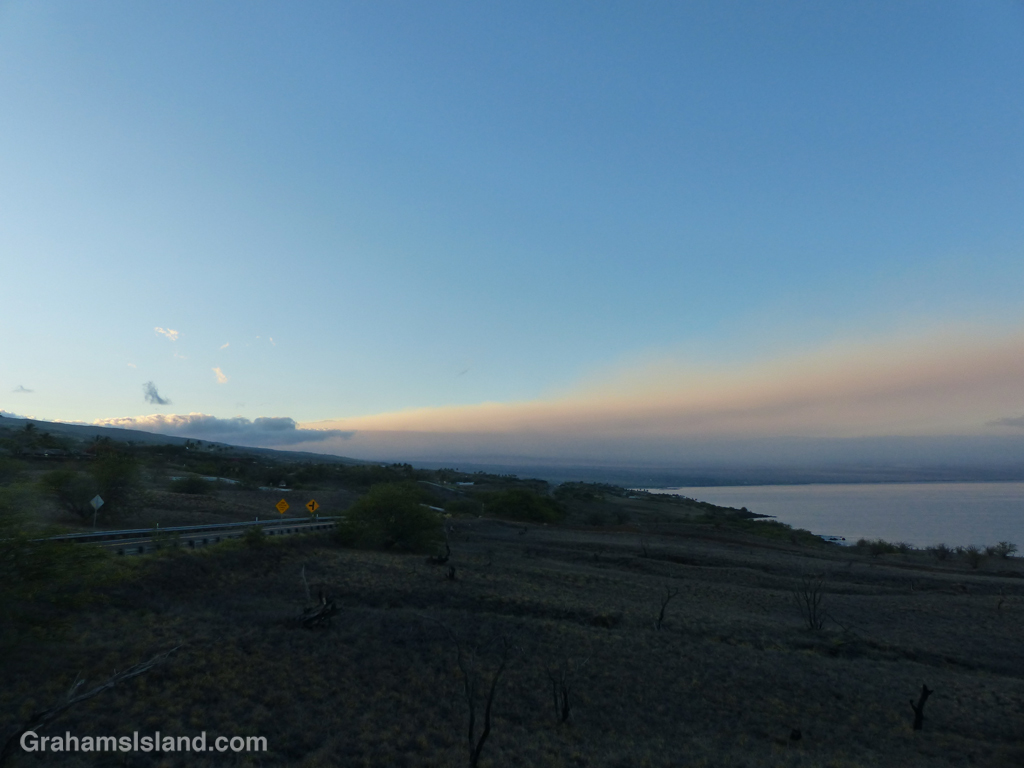 Smoke from a brush fire clouds the early morning sky