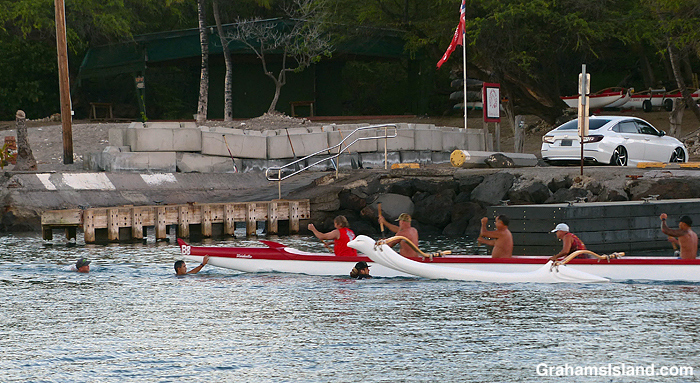 An outrigger canoe about to change paddlers in Hawaii