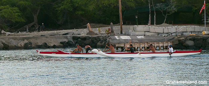 An outrigger canoe changing paddlers in Hawaii