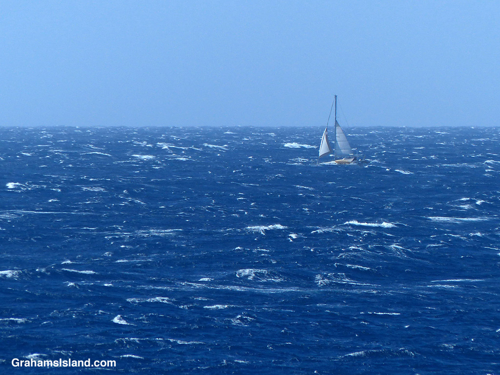 A sailboat in white water off the Big Island, Hawaii